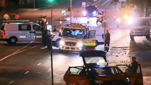 Man dies after being struck by taxi while crossing road in Brisbane