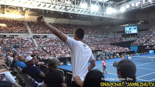 Jamie Zhu approached the edge of a stand overlooking the Melbourne Park court, pulled out his phone to film a video and began howling. (YouTube/Jamie Zhu)