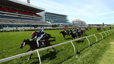 Jye McNeil riding #6 Twilight Payment wins the Melbourne Cup.