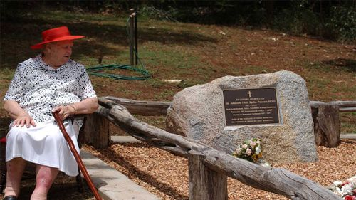 Lady Bjelke-Petersen sits at the grave of Sir Joh Bjelke-Petersen on the family property Bethany at Kingaroy, north west of Brisbane in 2006. (Image: AAP)