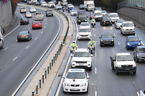 The motorcade carrying Prince Harry, the Duke of Sussex and his wife Meghan, the Duchess of Sussex, makes its way through peak-hour traffic on the Eastern Distributor in Sydney.