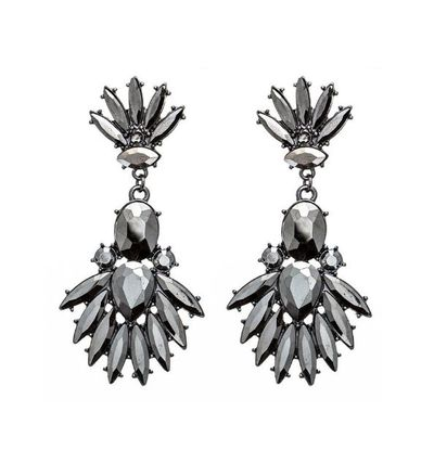"Real ice or just a pretty piece of crystal - no matter. Both versions will give you a touch of Amal's up-market style. <a href=""https://www.colettehayman.com.au/collections/jewellery/products/stn-fan-drop-er-3"" target=""_blank"">Colette by Colette Hayman Stone Fan Drop Earrings, $17.</a>"