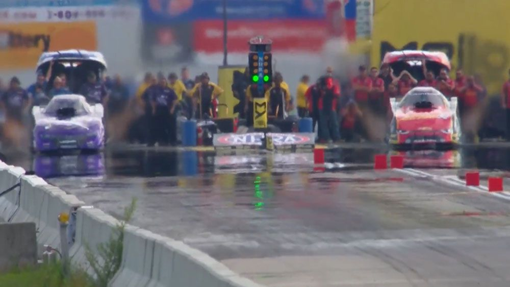 Drag car speeds down raceway while bursting into flames at NHRA New England Nationals