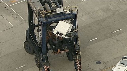 The woman fell from an industrial vehicle. (9NEWS)