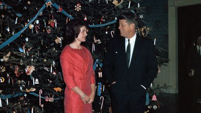 John F Kennedy and Jackie Kennedy with their 1961 White House Christmas tree.