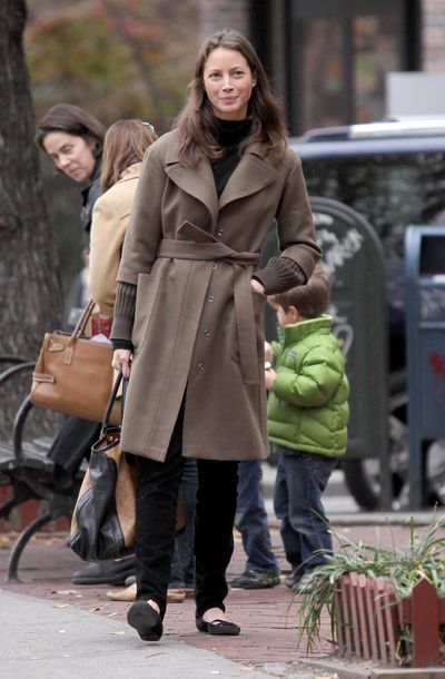 Christy Turlington knows a black turtleneck, trench coat and ballet flats tick all the style boxes for an elegant school run. She's picking up her daughter from school in Downtown Manhattan, New York in 2009.