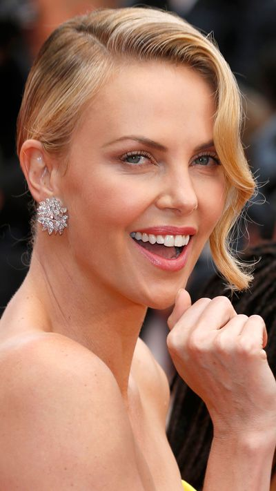 <p><strong>Day two</strong><br />A radiant <strong>Charlize Theron</strong>'s chose hair that gave a nod to old-school Cannes glamour.</p>