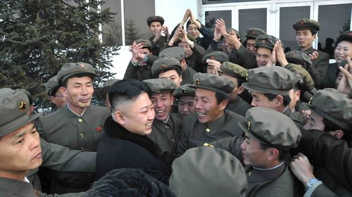 The popular Kim Jong-Un rushed by loyal soldiers (Getty).