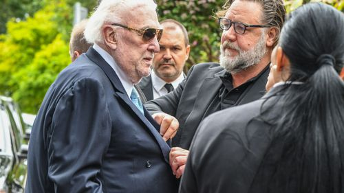 Actor Russell Crowe and John Laws at Caroline Laws' funeral.