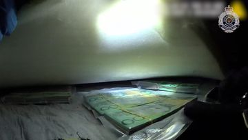 The money was allegedly found between the mattress of a bed on the property