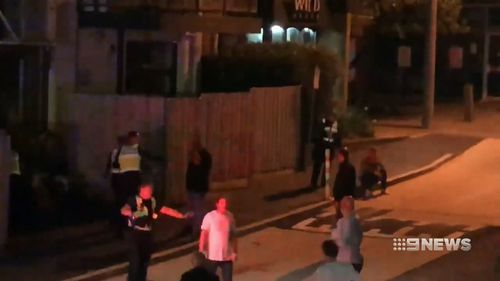Police arrived to break up the huge fight, but witnesses have accused them of using excessive force. (9NEWS)