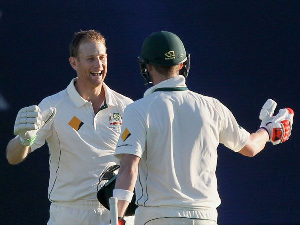 Adam Voges and Steve Smith celebrate at the end of play. (AAP)