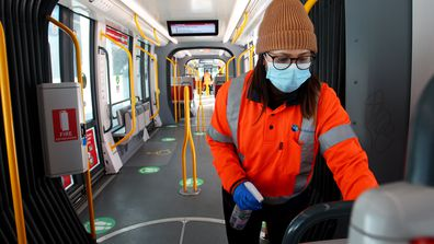 A member of the Sydney light rail cleaning team is seen wearing a face mask at Randwick Station on August 06, 2020 in Sydney, Australia.