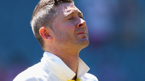 Australian cricket captain Michael Clarke watches on as the crowd pays tribute to Phillip Hughes ahead of the first Test against India. (Getty)