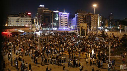 Supporters of Turkey's President Recep Tayyip Erdogan, gather in Istanbul's Taksim square. (AP)