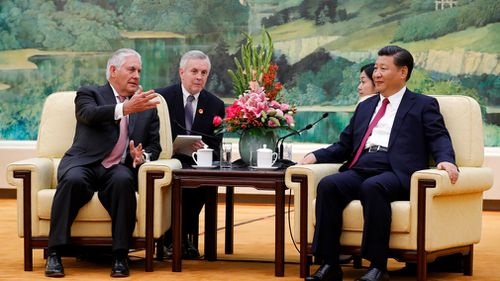 US Secretary of State Rex Tillerson, left, chats with China's President Xi Jinping during a meeting at the Great Hall of the People in Beijing on September 30. (AP)