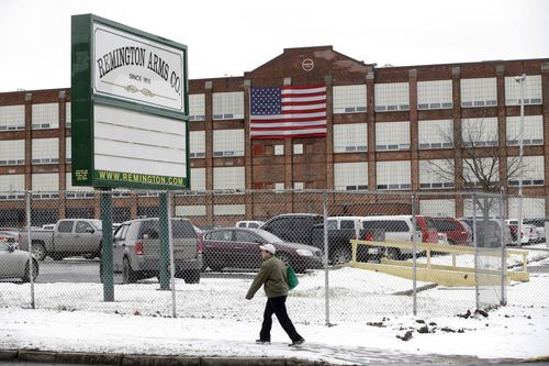 A man walks past the Remington Arms Company in Ilion, New York.