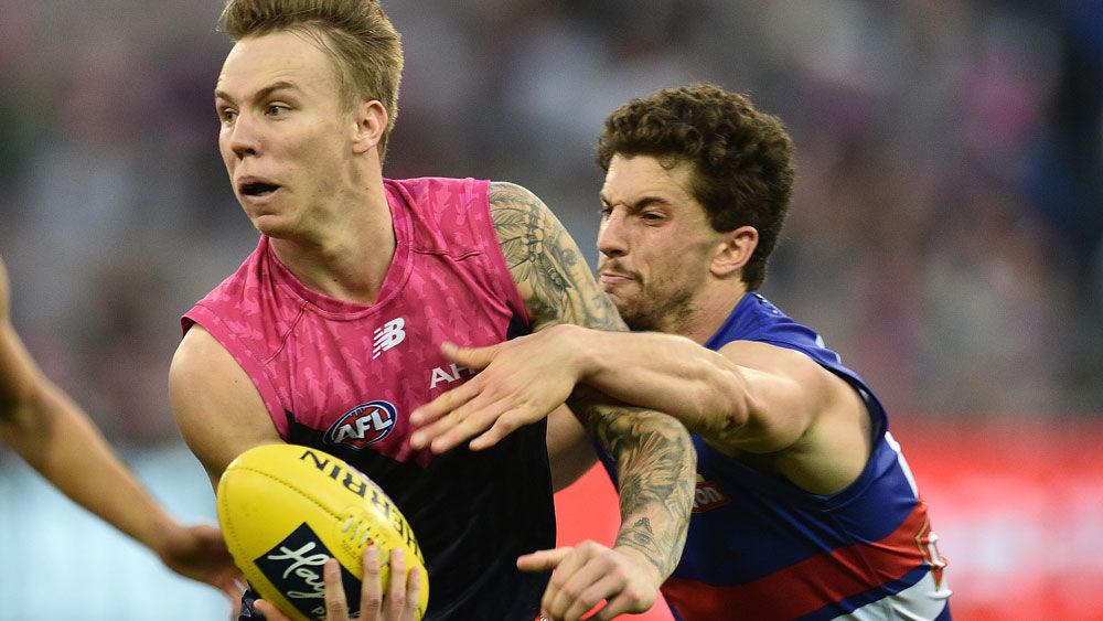 Bulldogs tackle Dees into AFL submission