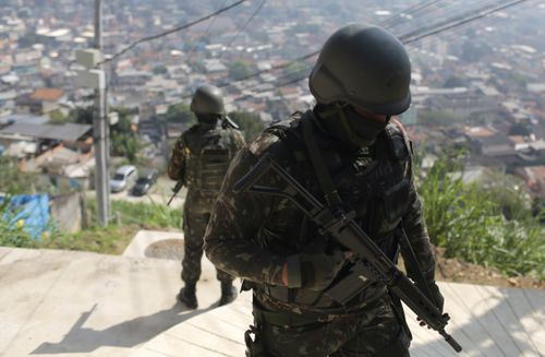In August 2018, at least eight people died during an operation against crime in favelas, which was conducted by 4,200 soldiers of the Brazilian Army, with the support of the police.  EPA/ANTONIO LACERDA