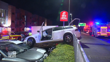 The out-of-control vehicle ploughed into the hotel carpark and landed on two parked vehicles.