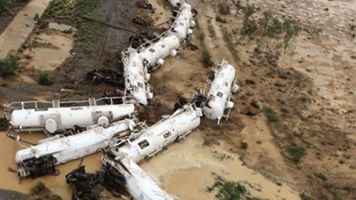 Fears derailed Queensland train is leaking acid