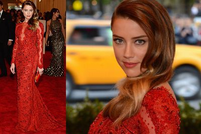 Johnny Depp's on-and-off girlfriend Amber Heard wears a custom red lace gown by Peter Dundas for Pucci on arrival at the MET Gala in NYC.