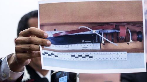 Carabinieri Colonel Lorenzo D'Aloia shows a picture of knife reportedly used to stab and kill Carabinieri officer Mario Cerciello Rega, during a press conference in Rome.
