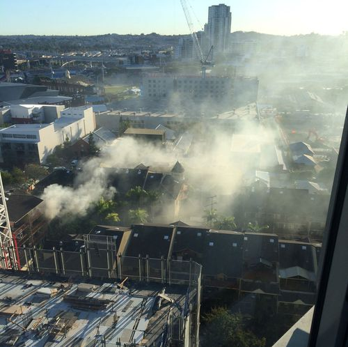 Smoke poured out of the apartment building. (Scott Koenig)