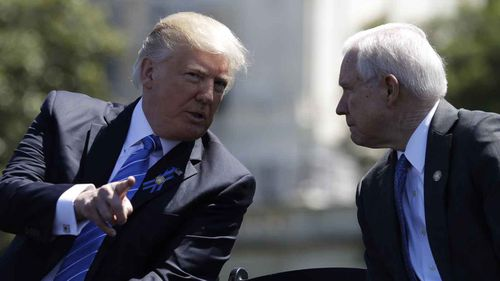 Donald Trump speaks with Jeff Sessions. (AAP)
