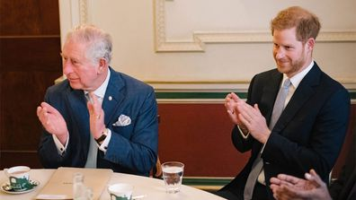 Prince Harry has joined his father Prince Charles at a round table discussion