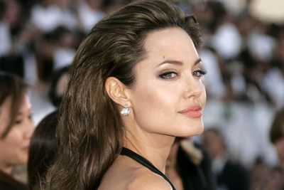 "<b>Angelina Jolie</b>'s known for having a dark side (wearing  vials of blood around her neck, for example) and there's no exception when it comes to the bedroom.  The seductress admitted that the first time she 'did it' things got a little, err, violent. ""In a moment of wanting to feel close to him, I grabbed a knife and cut him. He cut me back."" Geeez, close you say? That's a bit too close!"