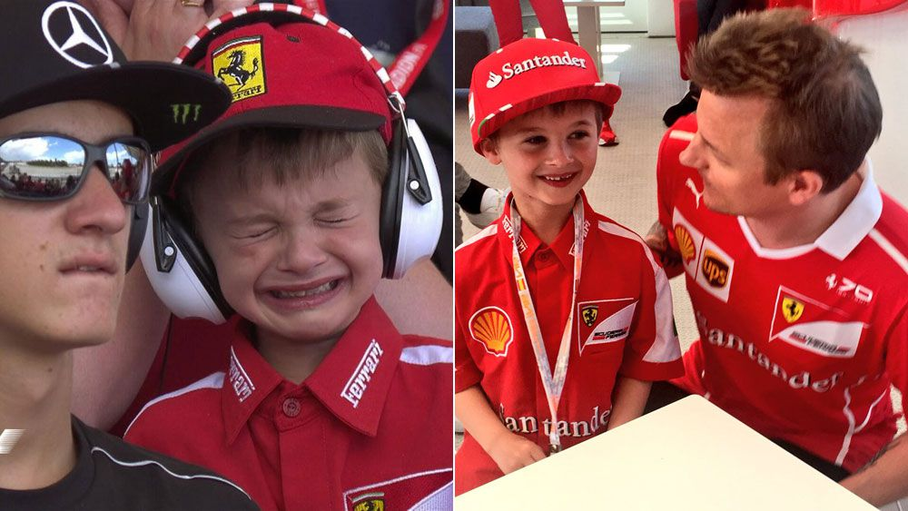 Kimi Raikkonen makes the day of a young fan.