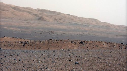 A handout photograph dated 23 August 2012 and released by NASA on 28 August 2012 a high-resolution colour picture looking south-southwest from the rover's landing site on planet Mars. (AAP)