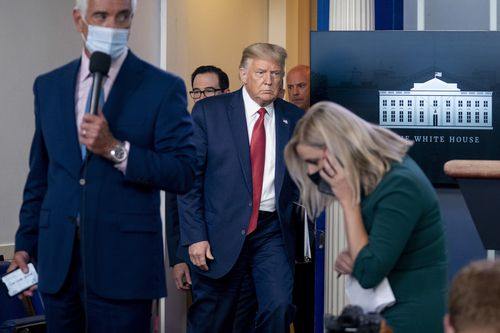 President Donald Trump returns to a news conference in the James Brady Press Briefing Room after he briefly left because of a security incident outside the fence of the White House