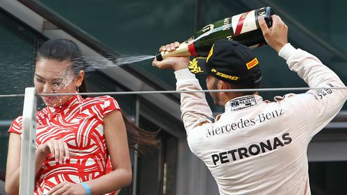 Podium hostess sprayed with champagne by Lewis Hamilton speaks out