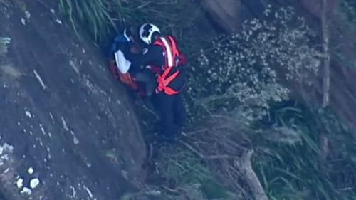 Emergency services work to rescue one of two boys.