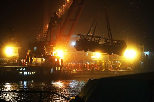 Rescuers lifted the wreck of the bus from the river Wednesday night local time. Thirteen bodies have been found and two remain missing, the official Xinhua News Agency said.