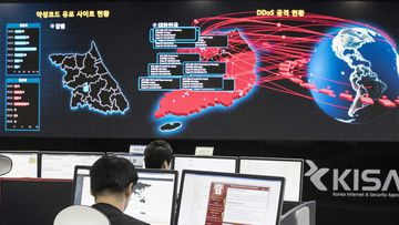 Employees watch electronic boards to monitor possible ransomware cyberattacks at the Korea Internet and Security Agency in Seoul, South Korea.