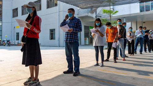 n this photo released by Xinhua News Agency, residents wearing masks line up for COVID-19 vaccination at the Jingcheng Hospital in Ruili city in southwestern China's Yunnan Province, April 1, 2021.