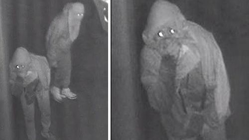 The men were seen sneaking around the taxi depot. (Victoria Police)