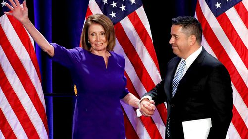 Democratic House Minority leader from California Nancy Pelosi and Democratic Congressional Campaign Committee chair Ben Ray Lujan from New Mexico on election night at the Hyatt Regency in Washington, DC. (AAP)