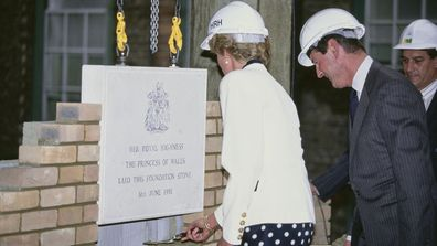 Diana, Princess of Wales lays a ceremonial foundation stone in a wall at the Royal Marsden Hospital in London, 6th June 1990