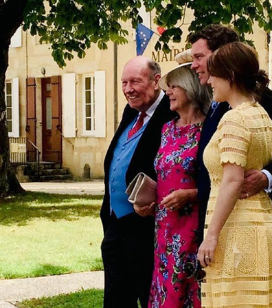 Eugenie pictured with her in laws and husband Jack.