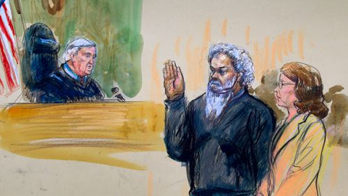 United States Magistrate, Judge John Facciola, swearing in the defendant, Libyan militant Ahmed Abu Khattala, wearing a headphone, as his attorney Michelle Peterson watches. (AP)