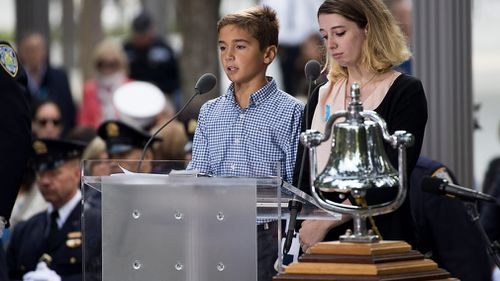 Relatives of those killed in the Twin Towers read out names of the victims. (AFP)