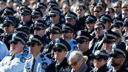 Officers pay their respects at Senior Constable Brett Forte's funeral.