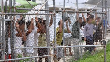 Protests broke out at Manus Island detention centre yesterday where refugees carried signs and chanted, demanding freedom. (AAP)