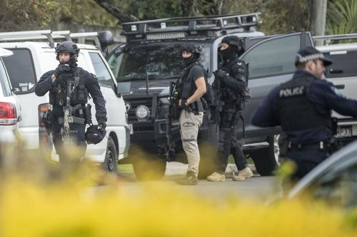 Police surround the Alexandra Headland unit during the siege. Picture: AAP