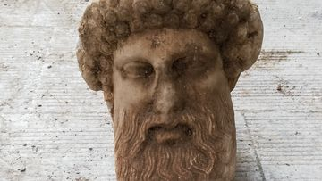 """In this undated photo, provided by the Greek Culture Ministry a head of the ancient god Hermes is pictured after being found during sewage works in central Athens. The ministry said Sunday that the head, depicting Hermes at a """"mature age"""", one of many that served as street markers in ancient Athens, appears to be from around 300 BC, that is, either from the late 4th century BC, or the early 3rd century."""