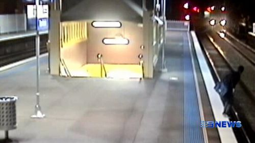 The man was captured on CCTV cameras jumping onto tracks at Banksia Station. (9NEWS)